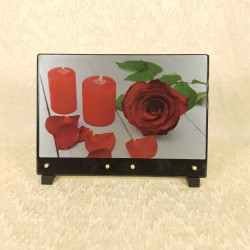 Plaque avec bougies et rose